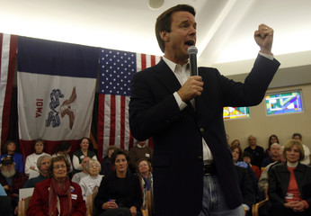 U.S. Democratic Presidential candidate and former Senator Edwards shakes his fist as he campaigns in Fort Dodge