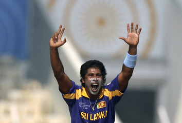 Sri Lanka's Vaas appeals successfully for the wicket of New Zealand captain Fleming during a match in Mumbai