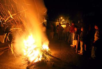 Members of the Oaxacan People's Popular Assembly stand near a night barricade in Oaxaca