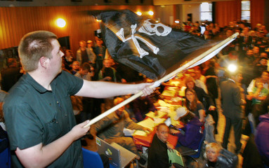 A supporter of Sweden's Pirate Party waves the Jolly Roger flag at an election night party as results are announced in EU Parliamentary elections in Stockholm