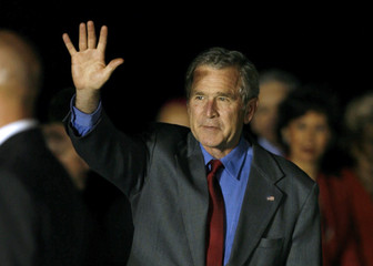 U.S. President George W. Bush waves as he arrives at at Rome's Fiumicino International airport