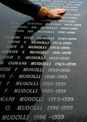 A Kosovo Albanian man visits a memorial for the dead from Kosovo's 1998-99 war in the town of Glogovac