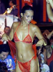 A REVELER DANCES IN A PARTY AT SCALA CLUB IN RIO DE JANEIRO.