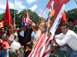 MANIFESTANTS BURN US FLAG DURING PROTEST IN BRASILIA.