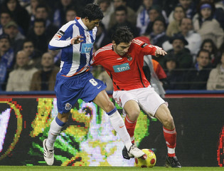 Porto's Lucho battles for the ball with Benfica's Katsouranis during their Portuguese Premier League soccer match at Dragao stadium in Porto
