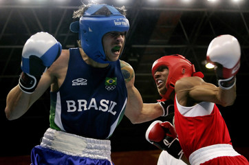 Karl Dargan of U.S. and Myke Carvalho of Brazil exchange punches in men's Light Welterweight semi-final boxing match at the Pan American Games in Rio de Janeiro