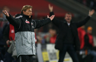 Cologne's new coach Christoph Daum reacts during his team's German second division match against Duisburg in Cologne