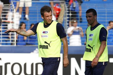 Italy's Cassano and Di Natale talk during a training session at the Suedstadt stadium in Maria Enzersdorf