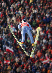 Poland's Malysz soars through the air during the Large Hill Individual ski jumping event in Oberstdorf.