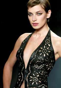 A model wears a cutwork leather vest at the Carmen Marc Valvo Spring 2003 fashion show in New York C..