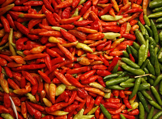 Red and green chillies are seen at a traditional market in Jakarta