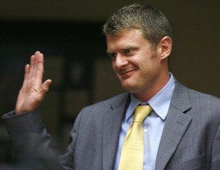 U.S. cyclist Floyd Landis takes the oath as he is sworn in to testify at an arbitration hearing in Malibu