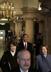 President-elect Barack Obama walks through the U.S. Capitol crypt during inaugural ceremony in Washington
