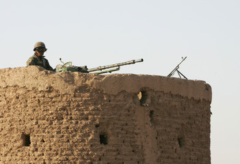 Afghan soldier mans a heavy machine gun at the Shindand airbase.