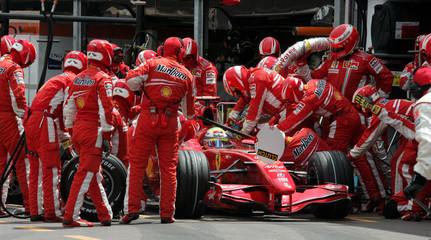 Mechanics seen around the car of McLaren Formula One driver Massa of Brazil during the Monaco's F1 Grand Prix
