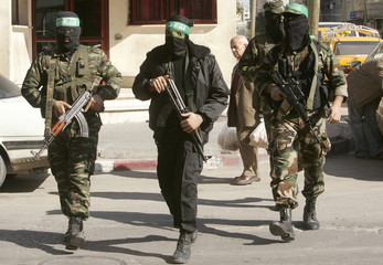 Palestinian Hamas militants arrive for a news conference in Gaza