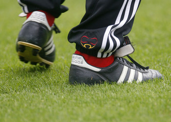 Shoes of Germany coach Loew are seen during a soccer training session in Kamen