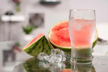Cup of water and watermelon, diet concept