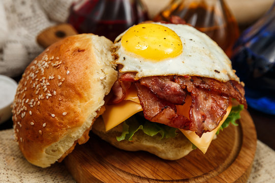 Bacon burger with beef patty and egg yolk
