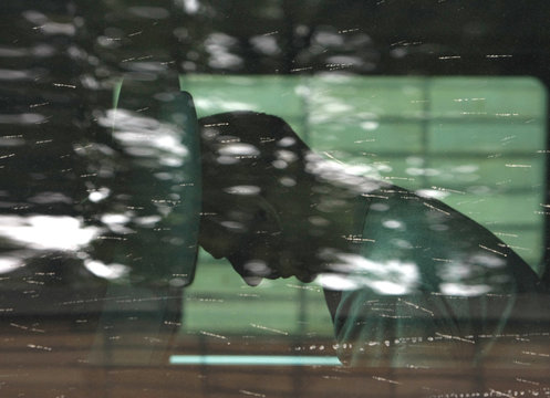 A detained man is seen through the tinted windows of a bus driving into Moscow's high-security Lefortovo prison