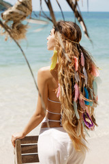 attractive young boho woman at the beach
