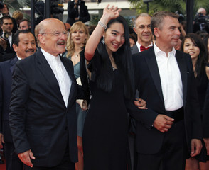 "German director Volker Schloendorff, actress Ayanat Ksenbai and French actor Philippe Torreton arrive for a gala screening of British director Michael Winterbottom's film ""A Mighty Heart"" at the 60th Cannes Film Festival"