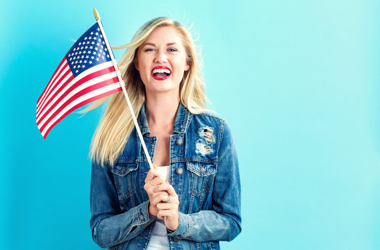 Young woman holding American flag