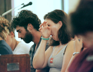 BACKPACKER SURVIVORS AT MEMORIAL SERVICE FOLLOWING A FIRE THAT KILLED UPTO 18 IN CHILDERS QUEENSLAND.