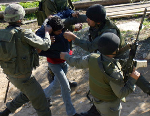 Palestinian youth is arrested during clashes near Ramallah.