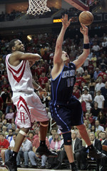 Houston Rockets forward Tracy McGrady knocks the ball from the hands of Utah Jazz forward Matt Harpring as he goes up for a shot in Houston
