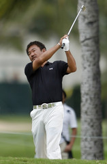 Mitsuhiro Tateyama of Japan hits a shot from the 17th fairway during the first round of the Sony Open golf tournament in Honolulu