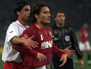 AS ROMA'S TOTTI IN ACTION WITH PERUGIA'S BLASI DURING MATCH IN ROME.