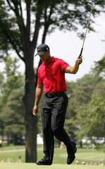 Woods reacts after making an eagle on the second hole during the final round of the WGC Bridgestone Invitational golf tournament in Akron