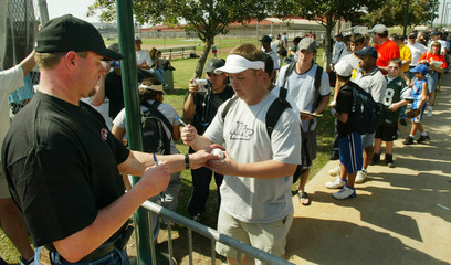 ASTROS ROGER CLEMENS SIGNS AUTOGRAPHS FOR FANS IN KISSIMMEE.