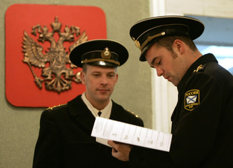 Sailors of Russia's Black Sea fleet read ballot papers at a polling station in Sevastopol