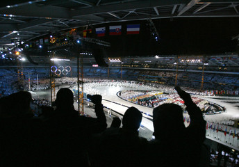 Spectators watch artists perform during opening ceremony of the Winter Olympic Games