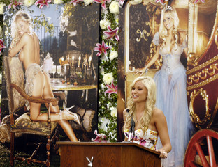 Playboy magazine's 2006 Playmate of the Year Monaco speaks in front of pictures from her layout in the magazine during a reception at the Playboy Mansion in Los Angeles