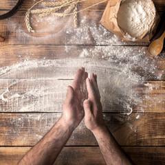 Fototapete - Man baker prepares a place for making dough