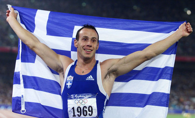 GREECE'S KENTERIS CELEBRATES WITH FLAG AFTER WINNING THE 200M FINAL IN SYDNEY.
