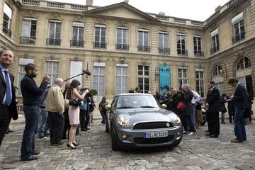 A Mini-E electric car by German luxury carmaker BMW is displayed during a news event at the Transport Ministry in Paris