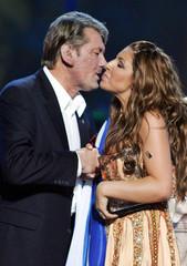Ukraine's President Yushchenko kisses Greece's Helena Paparizou during an award ceremony after the ...