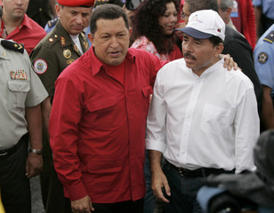 Venezuela's President Chavez and Nicaragua's President Ortega address the media after Chavez's arrival in Managua