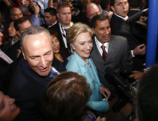 Former Democratic presidential candidate Clinton arrives on the convention floor with Senator Schumer and New York Gov. Paterson at the 2008 Democratic National Convention in Denver