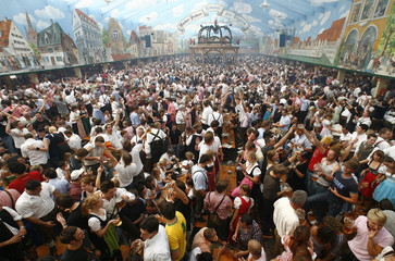 Beer drinkers are seen in one of the 14 the beer tents during the opening day of the 174th Oktoberfest beer festival in Munich