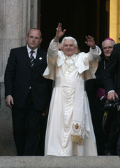 Pope Benedict XVI waves to the faithful gathered outside the Se Cathedral as he leaves after a meeting with Brazilian bishops in downtown Sao Paulo