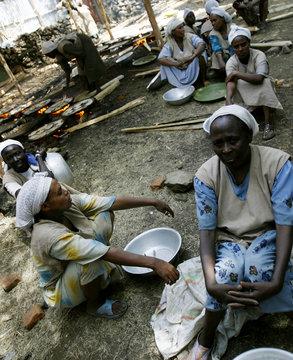 "Ethiopian women rest while ""matzah"" or unleavened bread burn in Gondor"
