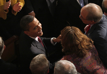 Obama is greeted by House of Representatives members during primetime address to joint session of Congress in Washington
