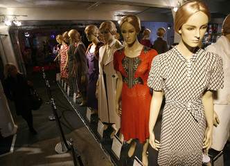Outfits worn by singer Madonna are displayed at the Madonna Materials of the Girl exhibition in London