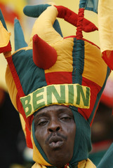 A Benin supporter wears a hat in his country's colours before the match against Ivory Coast during the African Nations Cup soccer match in Sekondi