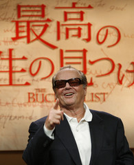 """Actor Jack Nicholson gestures at a news conference to promote his movie """"The Bucket List"""" in Tokyo"""